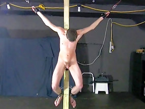 Young twink slave Ricky is whipped and crucified by master